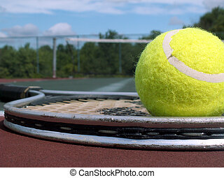 tennis ball and racket - tennis racket and two balls lying...