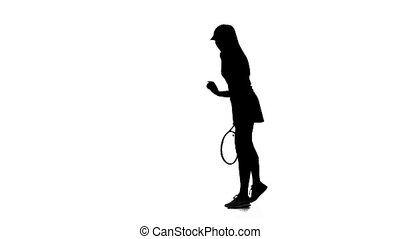 Tennis ball and stuffing picks up a racket. Slow motion. Silhouette