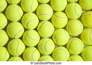 Background image full of tennis balls.