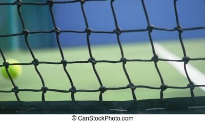 Tennis ball falling on a tennis court hit the grid. slow...