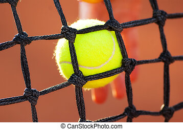 tennis ball in net