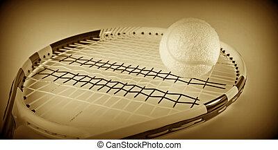 Tennis ball on a racket.