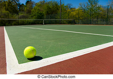 Tennis ball on Court - Bright greenish, yellow tennis balls...