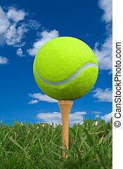 Tennis ball on golf tee