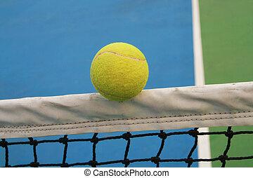 tennis ball on net