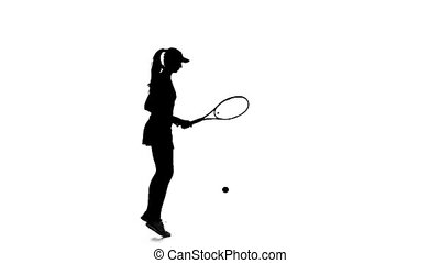Tennis ball on the floor fills the racket. Silhouette. Slow...