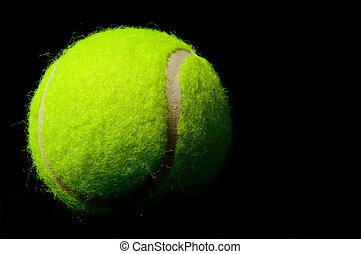 Tennis Ball - Tennis ball on black background lit from the...