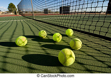 Tennis balls and court