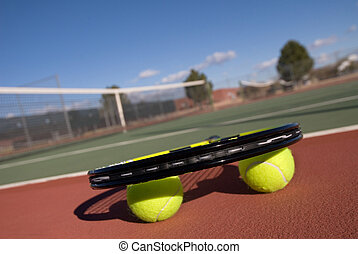 Tennis balls, court and racquet