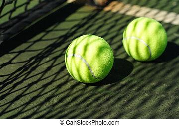 Tennis balls in court