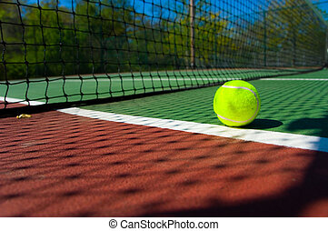 Tennis balls on Court - Bright greenish, yellow tennis ball...