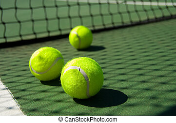 Tennis balls on Court - Bright greenish, yellow tennis balls...