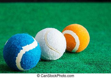 tennis balls on grass.
