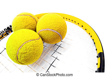 Tennis balls - Close-up on three tennis balls standing on...