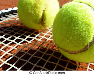 tennis balls - with racket on the course