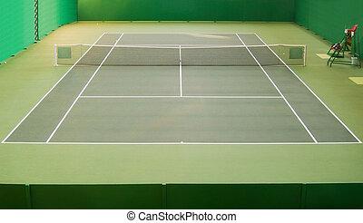 Empty green indoor tennis court