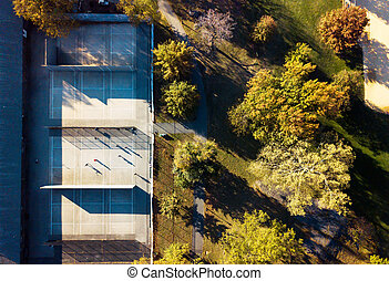 Tennis court in a park aerial view