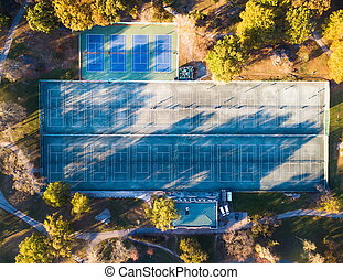 Tennis courts in a park aerial view