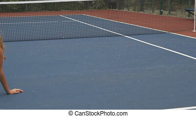 Tennis girl having a rest on court