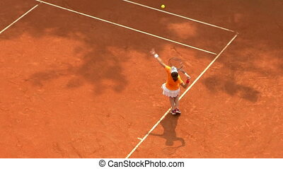 tennis girl orange serve game 01 - Girl play ball service on...