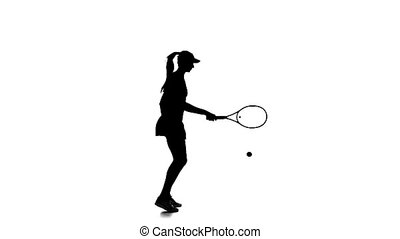 Tennis in the sports form fills ball racket edge. Silhouette. Slow motion.