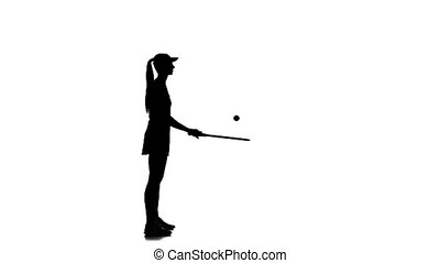 Tennis in the sports form fills racket ball. Silhouette. Slow motion
