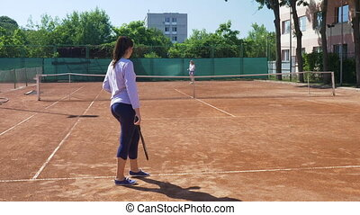 Tennis match between two young women friends