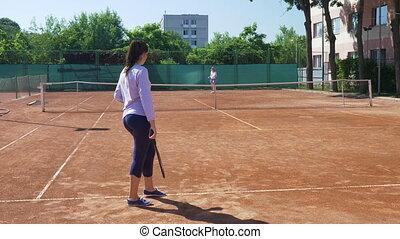 Tennis match between two young women friends