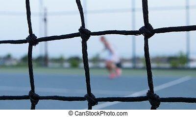 Tennis net in front. Tennis. Outdoor courts