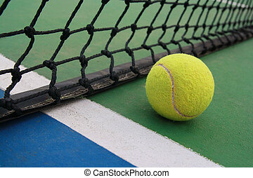 tennis on court with net