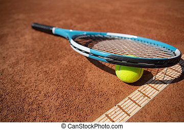 Tennis outfit is lying on sunny court