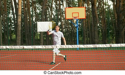 Tennis player approaching a forehand volley