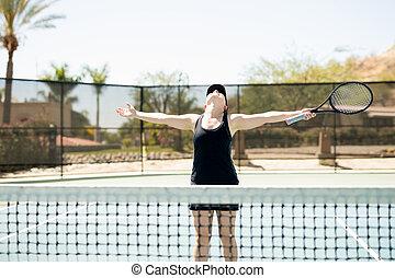 Tennis player celebrating her win