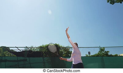Tennis player girl hits the ball with the racket in slow...