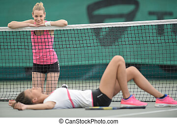tennis player on the ground after missing a shot