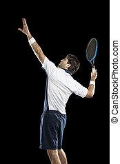Tennis Player. - Tennis player playing on a black...