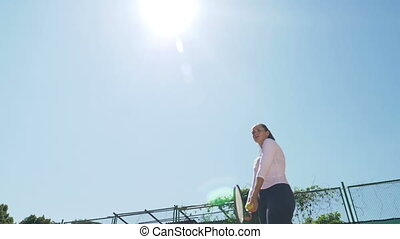Tennis player playing match in a sunny day