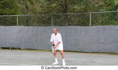 tennis player practice backhand