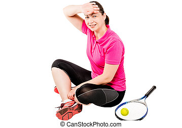 tennis player resting after a workout, and wipes the sweat from his forehead on a white background