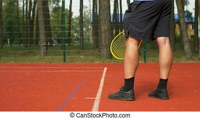 Tennis player serving a ball to start a point