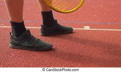 Tennis player serving ball to start a point