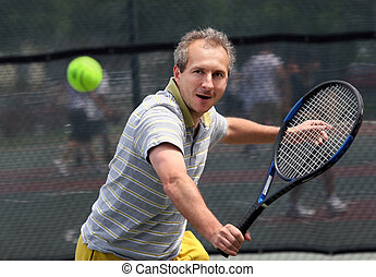 Tennis player - Middleaged man playing tennis