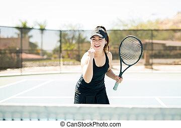 Tennis player winning a set
