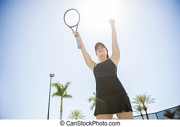 Tennis player winning the competition