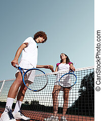 tennis players give the ball, fair play concept