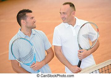 tennis players having a talk