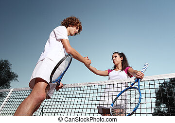 tennis players shaking hands, fair play concept
