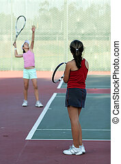 Tennis practice - Two girls at tennis practice