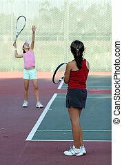 Tennis practice - Two girls at tennis practice