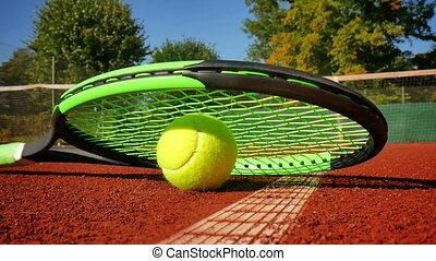 Professional tennis racket and a ball